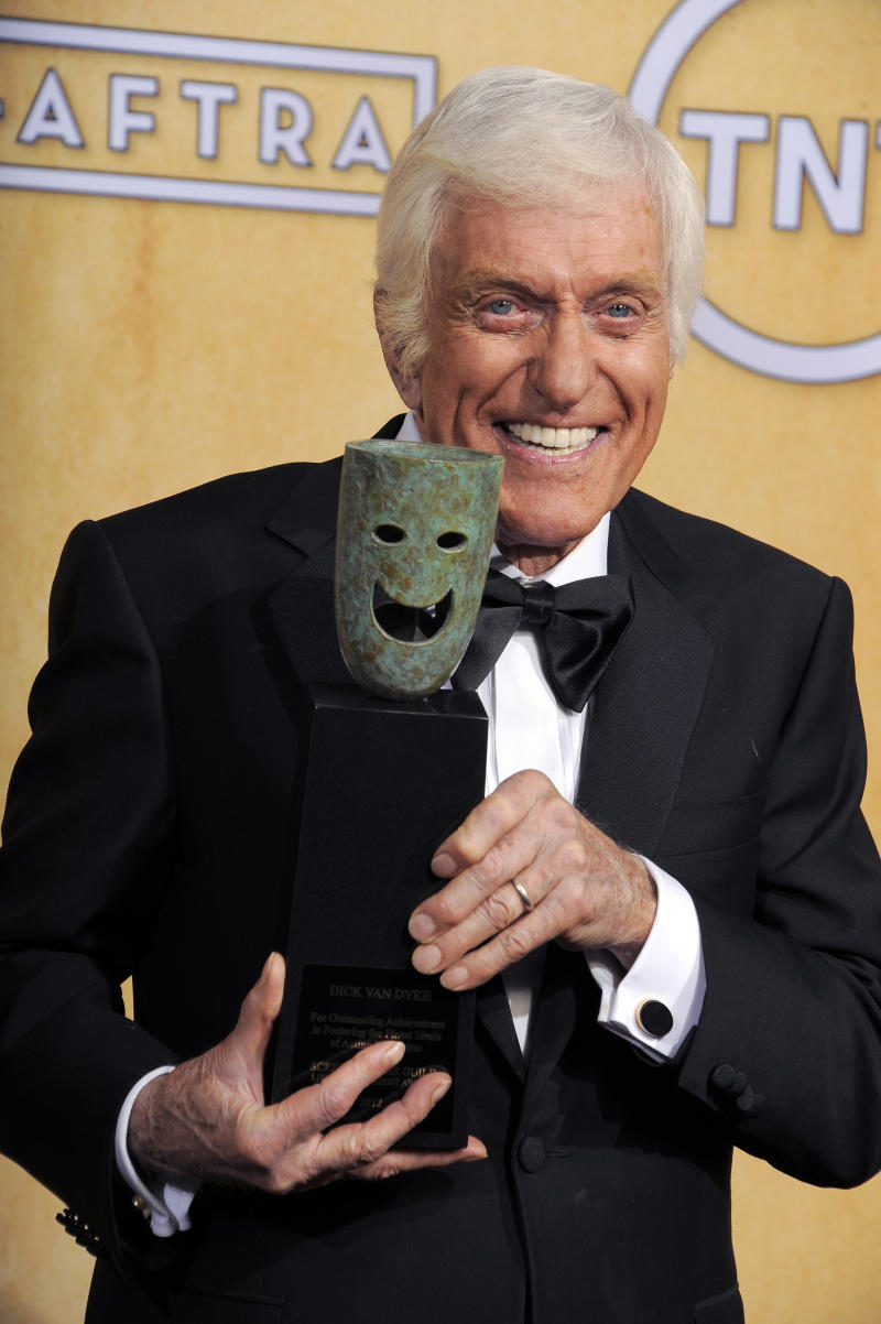 Actor Dick Van Dyke poses backstage with his life achievement award at the 19th Annual Screen Actors Guild Awards at the Shrine Auditorium in Los Angeles on Sunday Jan. 27, 2013. (Photo by Chris Pizzello/Invision/AP)