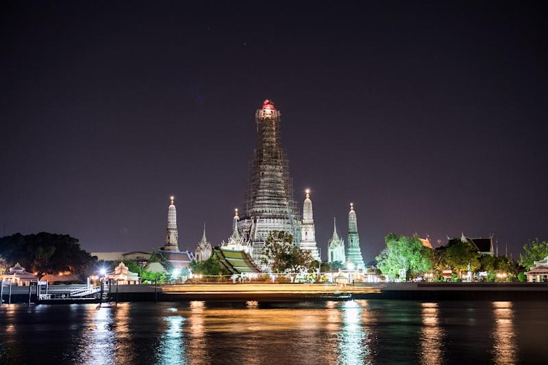 The two tourists photographed themselves baring their buttocks in front of Bangkok's famous Wat Arun