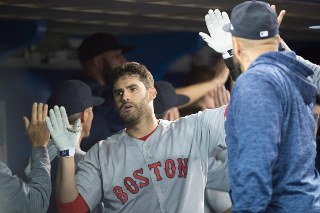 Boston Red Sox's J.D. Martinez reacts after hitting a three-run home run against the Toronto Blue Jays during the fifth inning of a baseball game in Toronto on Thursday, April 26, 2018. (Nathan Denette/The Canadian Press via AP)
