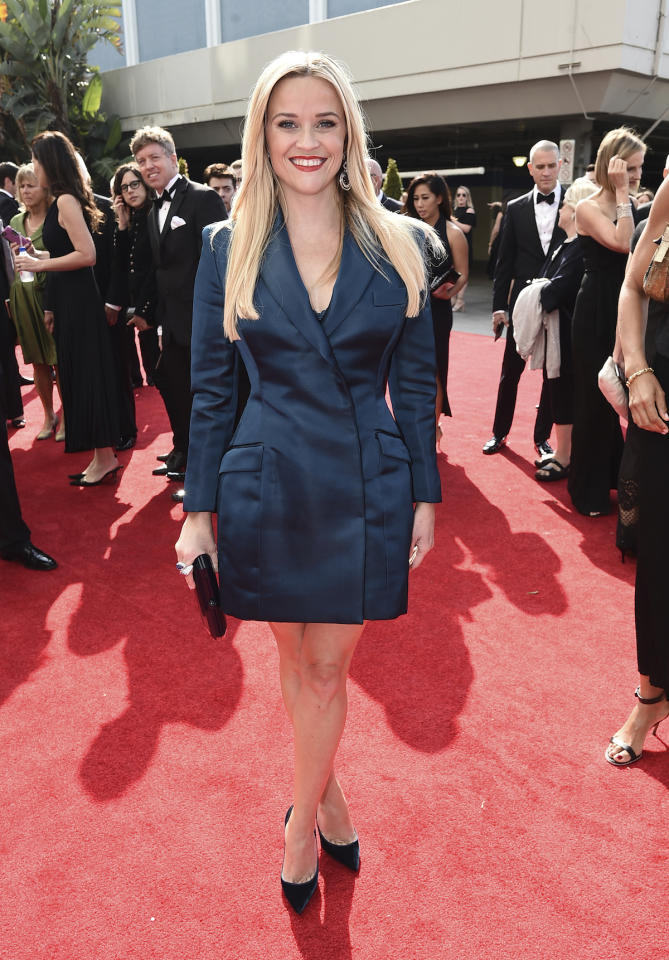 <p>Reese Witherspoon, who walked the red carpet with her <em>Big Little Lies </em>co-stars Laura Dern and Nicole Kidman, stood out on the red carpet by not wearing a gown. Instead, she opted for a silk tuxedo dress, counteracting the menswear vibes with pin-straight blond hair and bold red lip. (Photo: AP) </p>