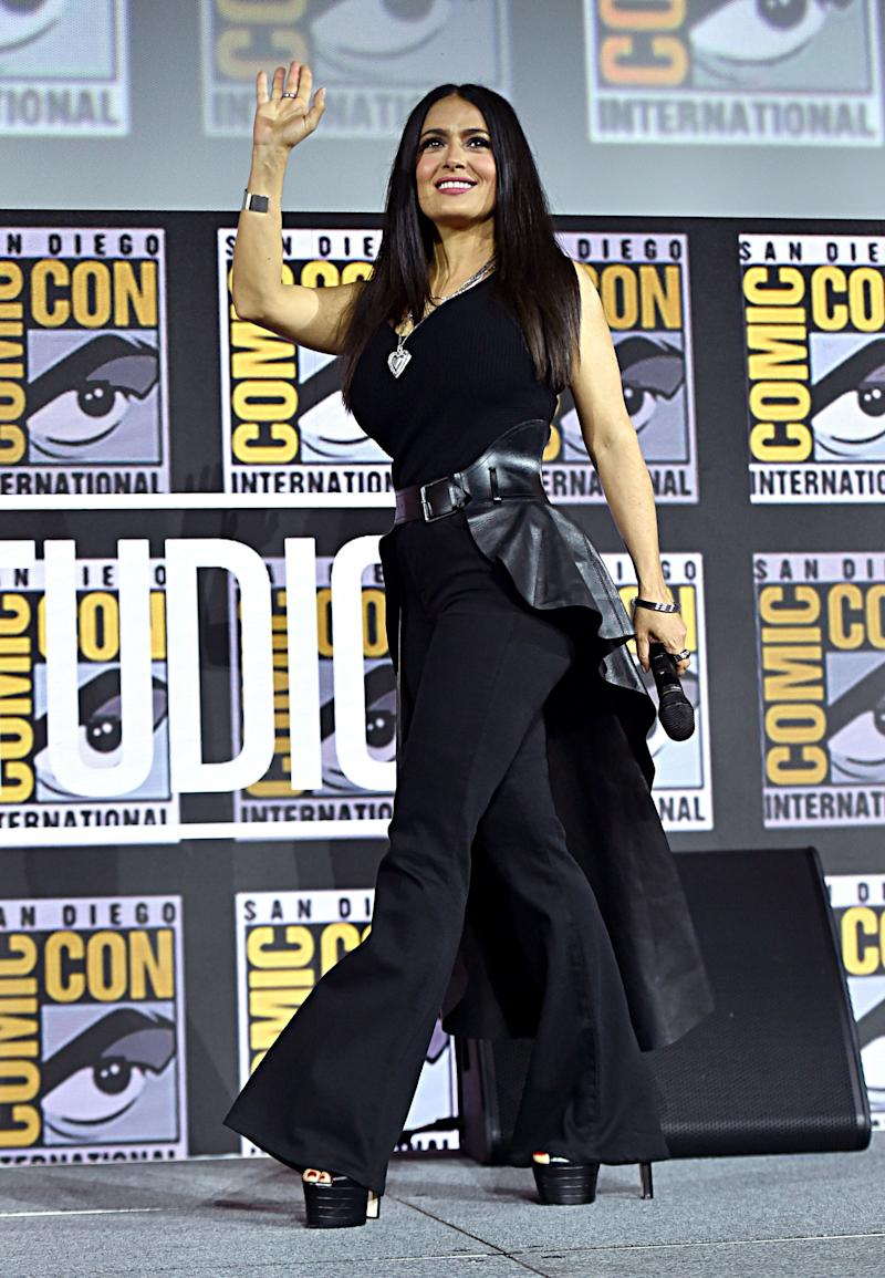 Salma Hayek looks dazzling in this black jumpsuit, and black heels to match as she waves to her fans.