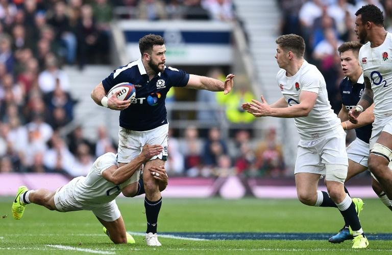 Scotland's centre Alex Dunbar (2L) is tackled by England's centre Jonathan Joseph (L) during the Six Nations international rugby union match between England and Scotland at Twickenham stadium in south west London on March 11, 2017