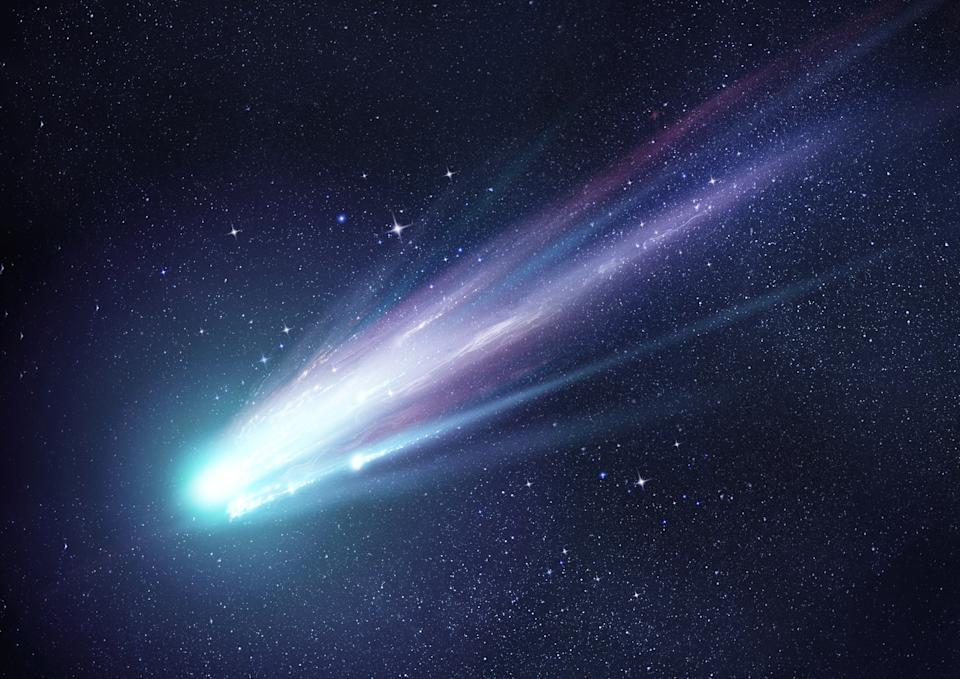 A bright comet with large dust and gas trails as the comets orbit brings it close to the Sun. Illustration.