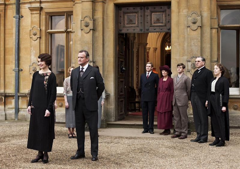 """This undated publicity photo provided by PBS shows, from left, Elizabeth McGovern as Lady Grantham, Hugh Bonneville as Lord Grantham, Dan Stevens as Matthew Crawley, Penelope Wilton as Isobel Crawley, Allen Leech as Tom Branson, Jim Carter as Mr. Carson, and Phyllis Logan as Mrs. Hughes, from the TV series, """"Downton Abbey."""" It was reliably delicious and also pretty deadly in its third season, which began last January. Lovely Lady Sybil died in childbirth. Then, in the season conclusion, Matthew Crawley, heir to Downton and Lady Mary's beloved, perished in a car crash, leaving her a widowed mother. Hankies were sopping as viewers faced a long wait for Season 4. (AP Photo/PBS, Carnival Film & Television Limited 2012 for MASTERPIECE, Nick Briggs)"""