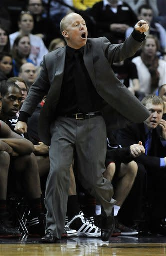 Cincinnati coach Mick Cronin directs his team against Georgetown during second half of an NCAA college basketball game Monday, Jan. 9, 2012, in Washington. Cincinnati defeated Georgetown 68-64. (AP Photo/Richard Lipski)