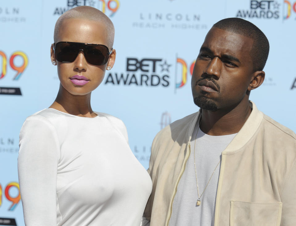 Rapper Kanye West poses with Amber Rose while arriving at the BET Awards '09 in Los Angeles June 28, 2009.   REUTERS/Phil McCarten          (UNITED STATES ENTERTAINMENT)
