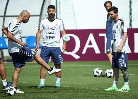 Argentina's Javier Mascherano, Sergio Aguero and Lionel Messi during training. REUTERS/Albert Gea