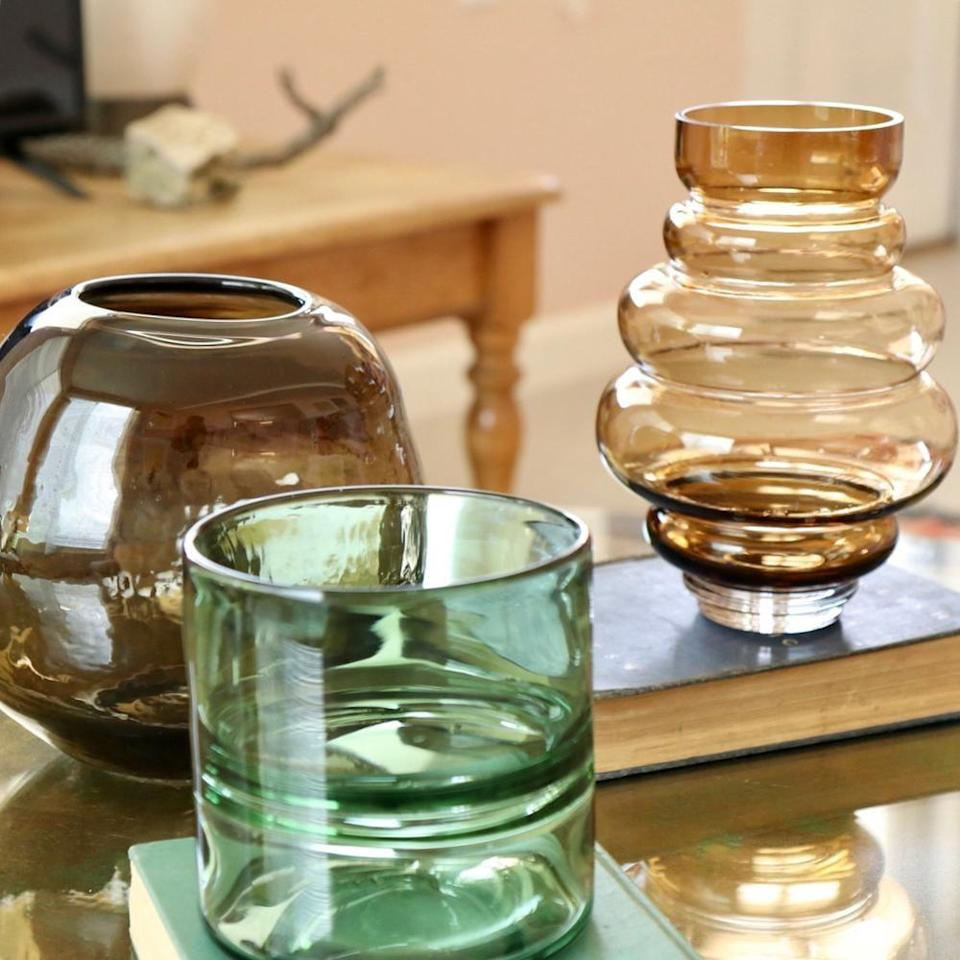 """<p>This <a href=""""https://www.popsugar.com/buy/Green-Glass-Split-Vase-582465?p_name=Green%20Glass%20Split%20Vase&retailer=effortlesscomposition.com&pid=582465&price=24&evar1=casa%3Aus&evar9=47553754&evar98=https%3A%2F%2Fwww.popsugar.com%2Fhome%2Fphoto-gallery%2F47553754%2Fimage%2F47553831%2FGreen-Glass-Split-Vase&list1=shopping%2Chome%20decorating%2Chome%20shopping&prop13=api&pdata=1"""" class=""""link rapid-noclick-resp"""" rel=""""nofollow noopener"""" target=""""_blank"""" data-ylk=""""slk:Green Glass Split Vase"""">Green Glass Split Vase</a> ($24) would look perfect on any table in your home.</p>"""