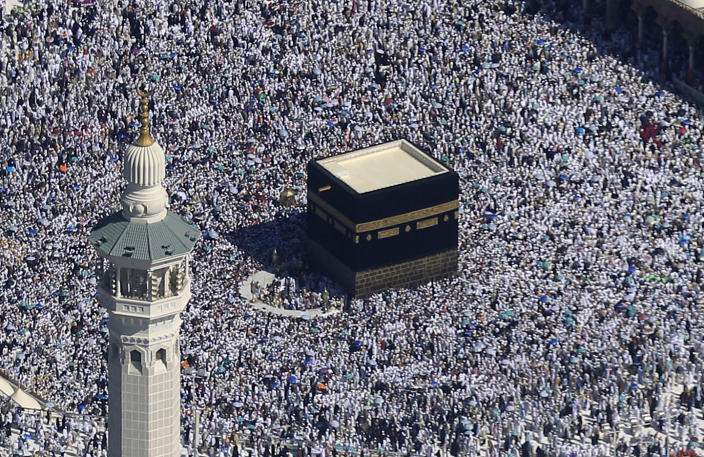FILE - This Nov. 7, 2011 file photo, made from a helicopter, shows Muslim pilgrims moving around the Kaaba, the black cube seen at center, inside the Grand Mosque, during the annual Hajj in the Saudi holy city of Mecca, Saudi Arabia. Muslims do not worship the Kaaba, but it is Islam's most sacred site because it represents the metaphorical house of God and the oneness of God in Islam. Observant Muslims around the world face toward the Kaaba during their five daily prayers. (AP Photo/Hassan Ammar, File)