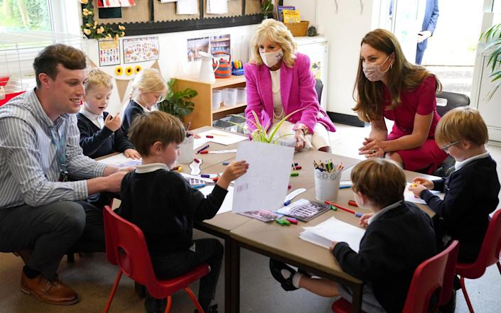 The First Lady and the Duchess of Cambridge talk with children in the school's Reception Class - Aaron Chown/PA Wire
