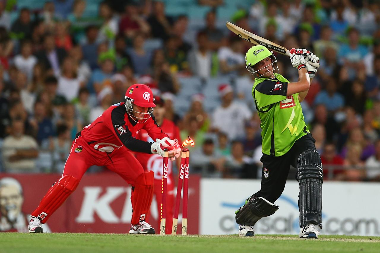 SYDNEY, AUSTRALIA - DECEMBER 14:  Peter Nevill of the Renegades attempts to stump Chris Tremain of the Thunder during the Big Bash League match between the Sydney Thunder and the Melbourne Renegades at ANZ Stadium on December 14, 2012 in Sydney, Australia.  (Photo by Mark Kolbe/Getty Images)