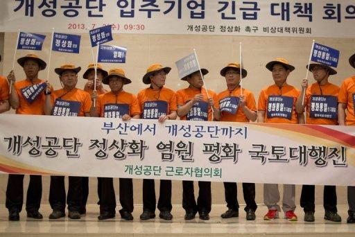 <p>South Korean businessmen involved in the joint-venture Kaesong industrial park in North Korea call for the 'normalisation' of relations after Pyongyang denied them access to the zone, in Seoul on July 3, 2013. Dozens of South Korean firms on Wednesday threatened to withdraw from Kaesong.</p>