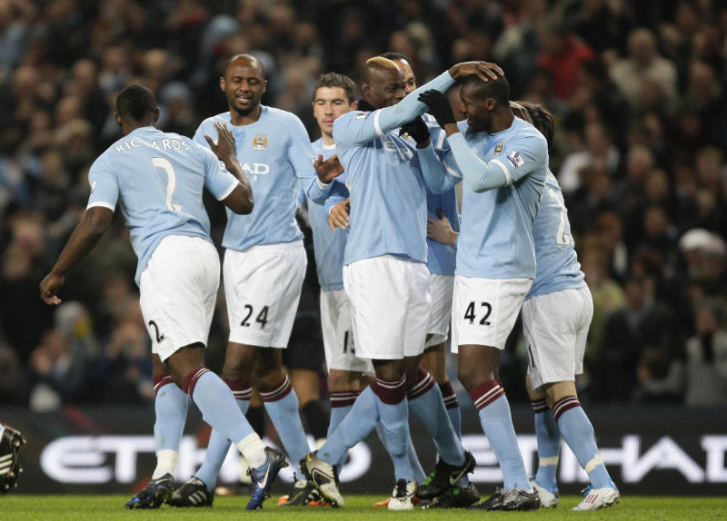 Manchester City's Yaya Toure, right, celebrates with teammates after scoring against Aston Villa during their English FA Cup fifth round  soccer match at The City of Manchester Stadium, Manchester, England, Wednesday, March 2, 2011. (AP Photo/Jon Super)   NO INTERNET/MOBILE USAGE WITHOUT FOOTBALL ASSOCIATION PREMIER LEAGUE(FAPL)LICENCE. EMAIL info@football-dataco.com FOR DETAILS.