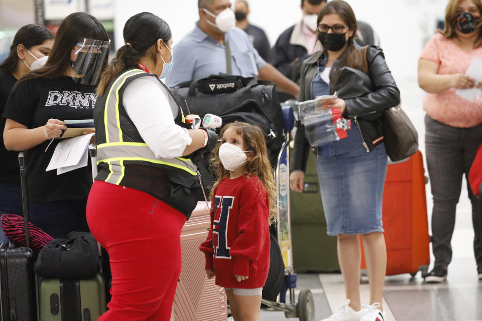 The CDC says symptom-based screening programs at airports are ineffective at detecting COVID-19. (Al Seib/Los Angeles Times)