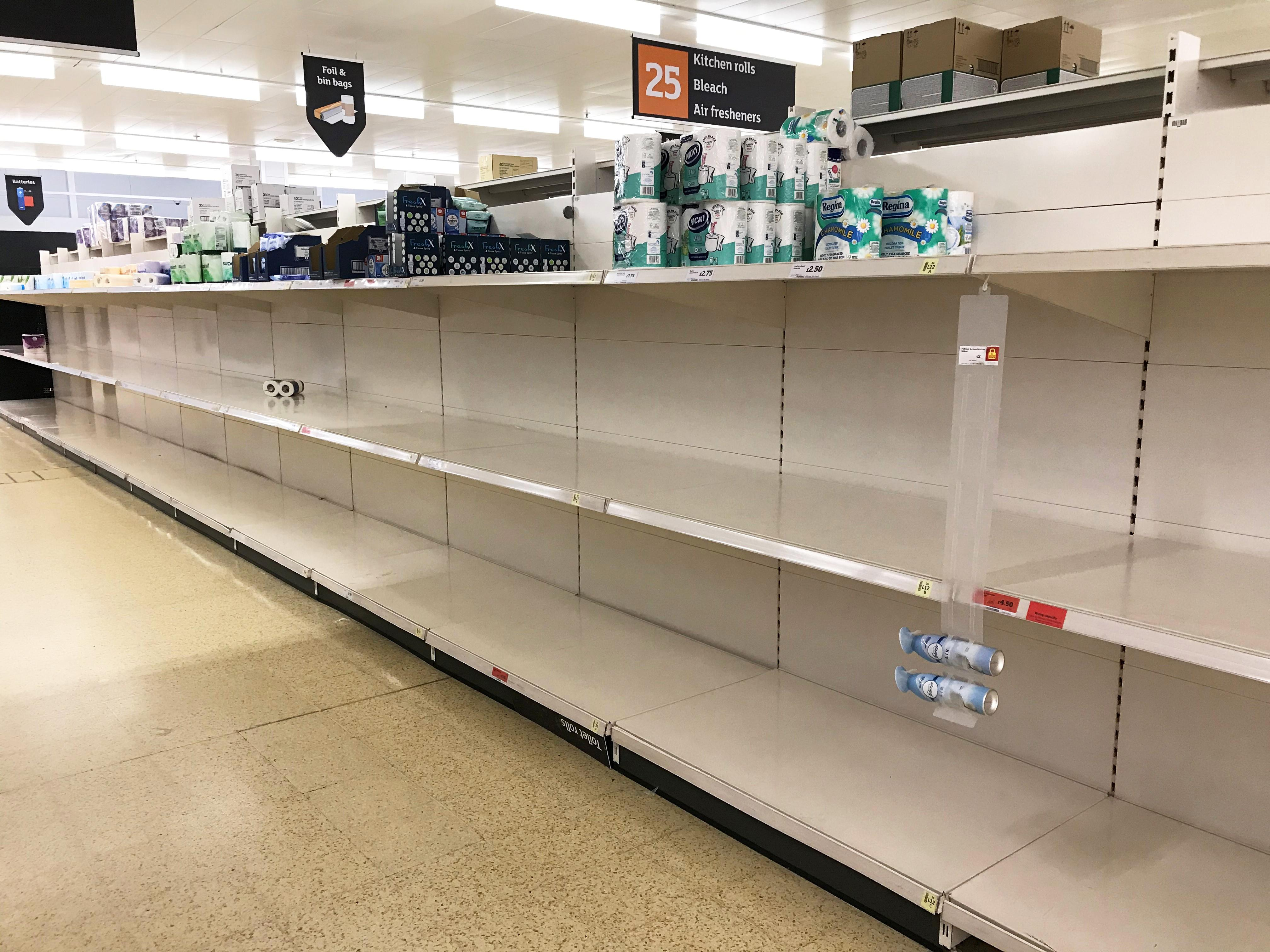 Empty toilet roll shelves in a Sainsbury's store in Basingstoke on Saturday. (PA)
