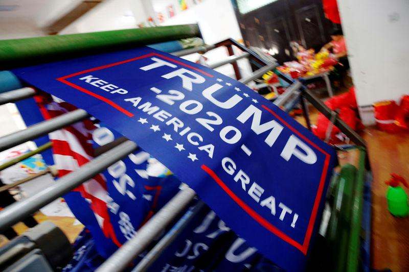 """FILE PHOTO: Flags for U.S. President Donald Trump's """"Keep America Great!"""" 2020 re-election campaign are seen at Jiahao flag factory in Fuyang"""