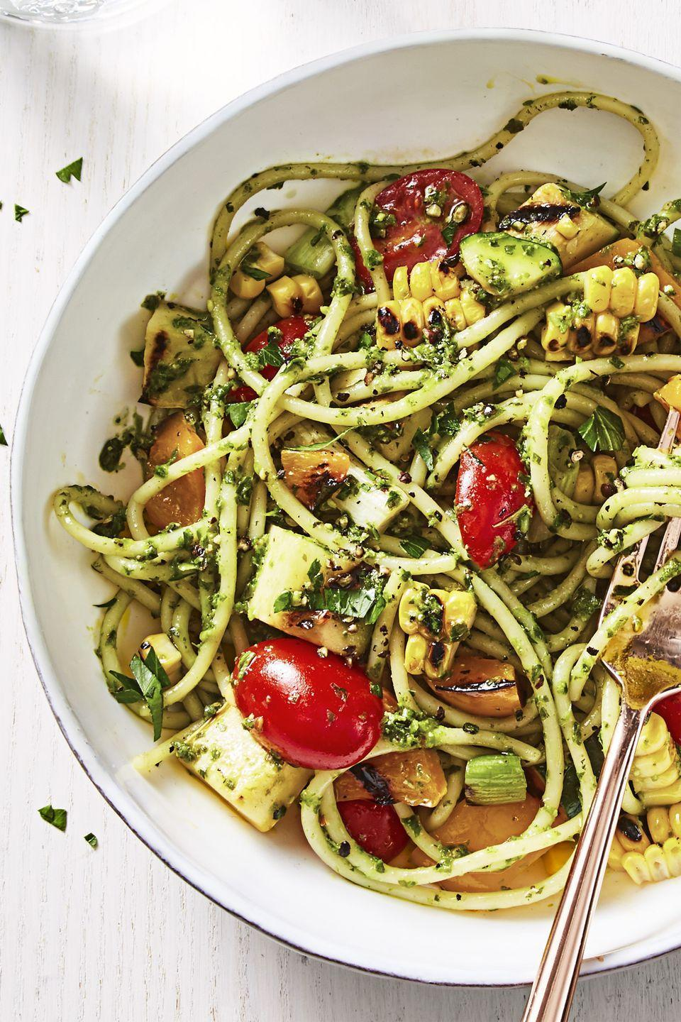 """<p>Bring this to a friend's barbecue bash, so you know for sure that there will be something for you to eat. Note: Be sure to buy vegan pesto (but, you knew that already!). </p><p><em><a href=""""https://www.goodhousekeeping.com/food-recipes/a44097/summer-pesto-pasta-recipe/"""" rel=""""nofollow noopener"""" target=""""_blank"""" data-ylk=""""slk:Get the recipe for Summer Pesto Pasta »"""" class=""""link rapid-noclick-resp"""">Get the recipe for Summer Pesto Pasta »</a></em></p>"""