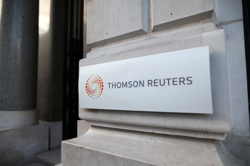FILE PHOTO: The logo of Thomson Reuters is pictured at the entrance of its Paris headquarters, France