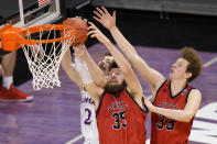 Kansas guard Christian Braun (2) Eastern Washington forward Tanner Groves (35) and Jacob Groves (33) battle for a rebound during the second half of a first-round game in the NCAA college basketball tournament at Farmers Coliseum in Indianapolis, Saturday, March 20, 2021. (AP Photo/AJ Mast)