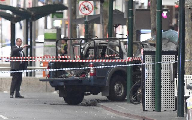 A burnt out vehicle on Bourke Street in Melbourne