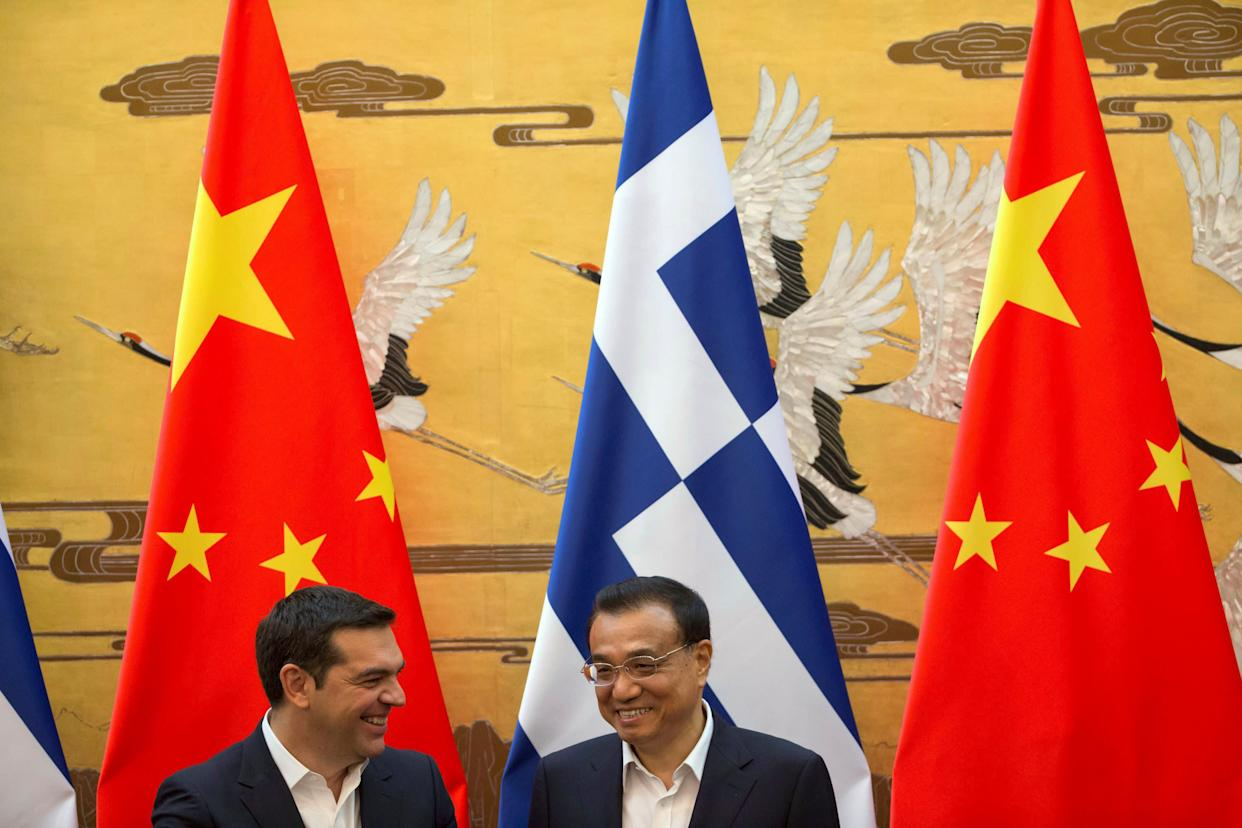Chinese Premier Li Keqiang (R) chats with Greek Prime Minister Alexis Tsipras (L) during a signing ceremony held at the Great Hall of the People in Beijing, China on July 4, 2016.  (Photo: POOL New / Reuters)