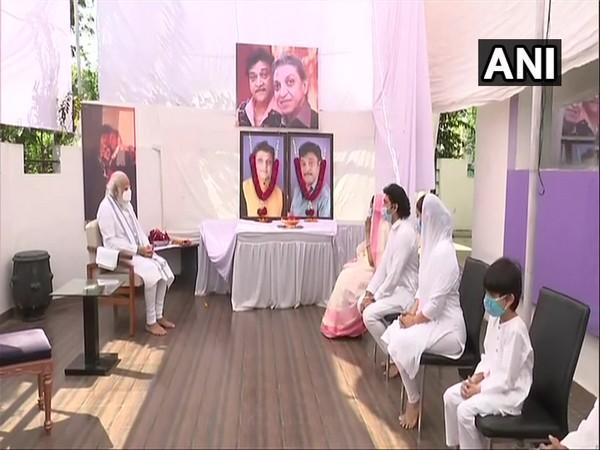 PM Narendra Modi with the family members of late Mahesh and Naresh Kanodia at their residence on Friday. Photo/ANI