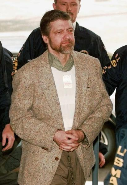 FILE-- In this June 21, 1997 file photo is Theodore Kaczynski, the convicted Unabomber who is serving a life sentence in a federal prison in Colorado for carrying out a series of mail bombings that killed three people. A federal grand jury in San Francisco indicted Vladislav Victorvic Timoshchuk, on charges of of mailing two envelopes containing ricin to Pelican Bay State Prison, officials announced on Friday Feb. 21, 2020. Last year the federal Bureau of Prisons intercepted a Christmas card from Timoshchuk, now living in Belarus, to Kaczynski, in which authorities say Timoshchuk discussed his plan to mail ricin to the United States. (AP Photo/Elaine Thompson, File)
