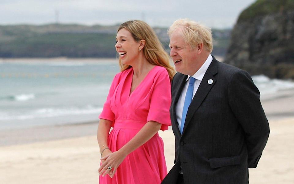 Boris Johnson stands next to Carrie Johnson during the G7 summit in Carbis Bay, Cornwall - Boris Johnson stands next to Carrie Johnson during the G7 summit in Carbis Bay, Cornwall