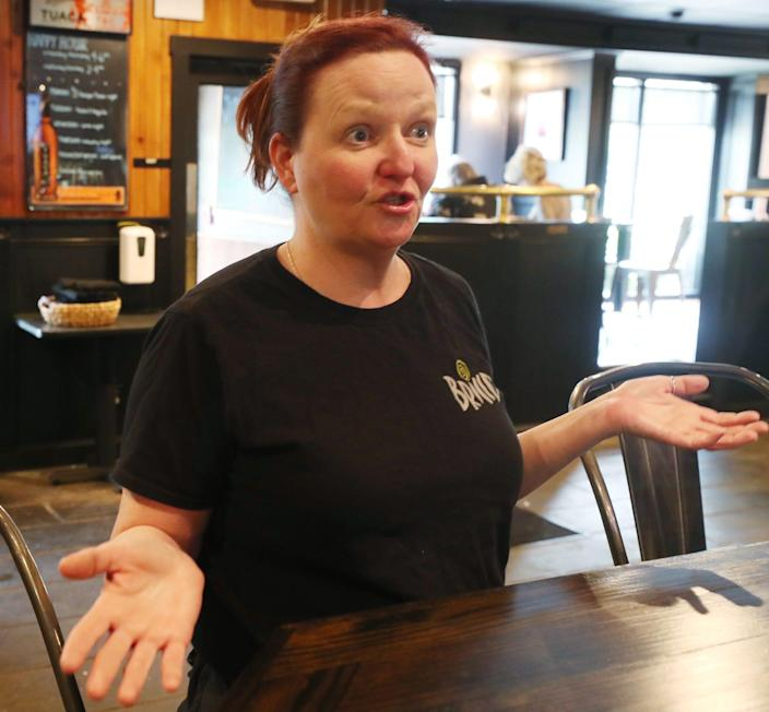 Amy Flener at server at Pub Bricco  talks about having to work a second restaurant job putting in a 70 hour week to earn what she used to make working 40 hours prepandemic as she waits to get her first table of the day in Akron on Wednesday June 9, 2021.