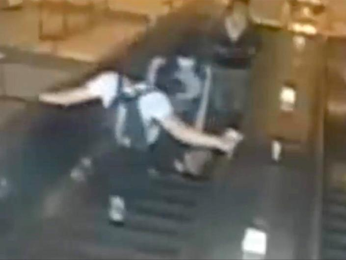 Police are hunting a man who kicked a woman down a Subway escalator in Brooklyn after they had a verbal exchange (NYPD)