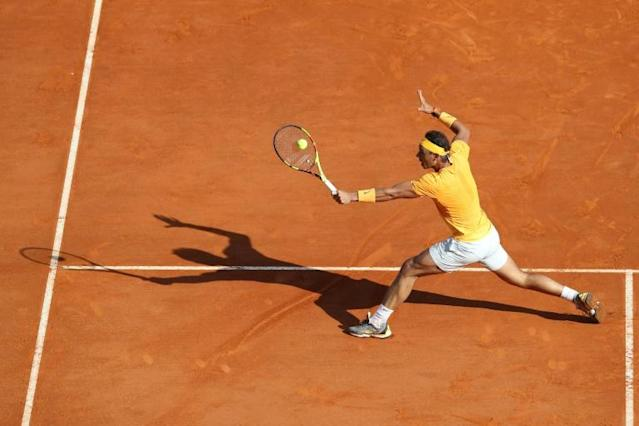 Spain's Rafael Nadal returns a ball to Russia's Karen Khachanov during their round of 16 tennis match at the Monte-Carlo ATP Masters Series Tournament in Monaco (AFP Photo/VALERY HACHE)