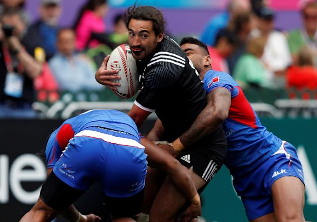 Rugby Union - Hong Kong Sevens - New Zealand v Samoa - Hong Kong Stadium, Hong Kong, China - April 7, 2018 New Zealand's Jordan Bunce is tackled by Samoa players. REUTERS/Bobby Yip