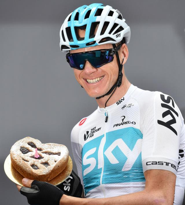 Chris Froome of Britain shows a cake with candle to celebrate his birthday, prior to the start of the 15th stage of the Giro d'Italia from Tolmezzo to Sappada, in Tolmezzo, Italy, Sunday, May 20, 2018. . (Daniel Dal Zennaro/ANSA via AP)