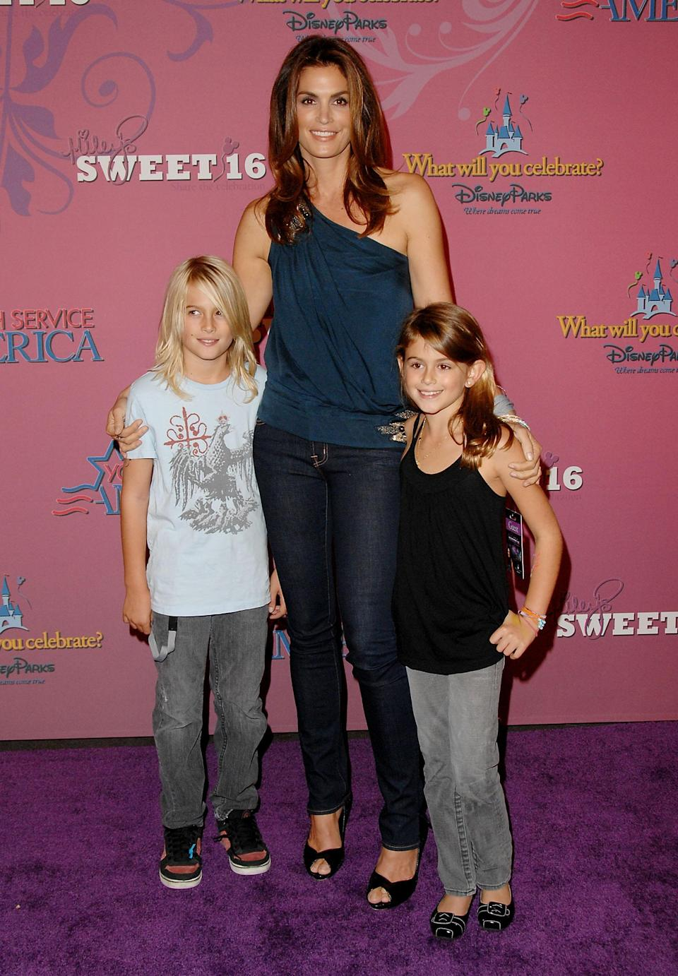 In 2008, Kaia and her brother Presley both attended Miley Cyrus's <em>Sweet 16</em> celebration at Disneyland with their supermodel mom. Kaia wore trendy grey skinny jeans and a simple black tank — how model-off-duty of her.