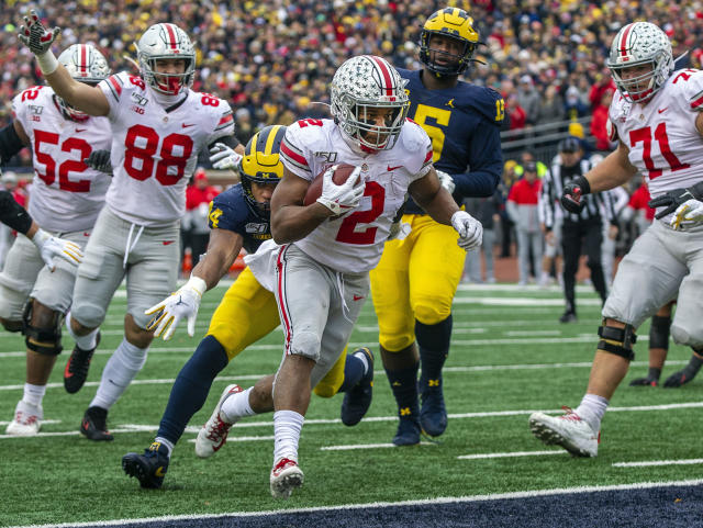 Ohio State running back J.K. Dobbins (2) scores a touchdown in the second quarter against Michigan on Saturday in Ann Arbor. (AP Photo/Tony Ding)