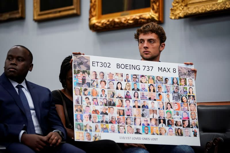 FILE PHOTO: Adnaan Stumo, who lost his sister Samya Rose Stumo in the Ethiopian Airlines Flight 302 crash hold a poster during a House Appropriations subcommittee hearing on aviation certifications, on Capitol Hill in Washington