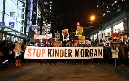 Protesters walk down Robson Street in opposition to Canada's decision to approve Kinder Morgan Inc's pipeline from the Alberta oil sands to the Pacific coast in Vancouver