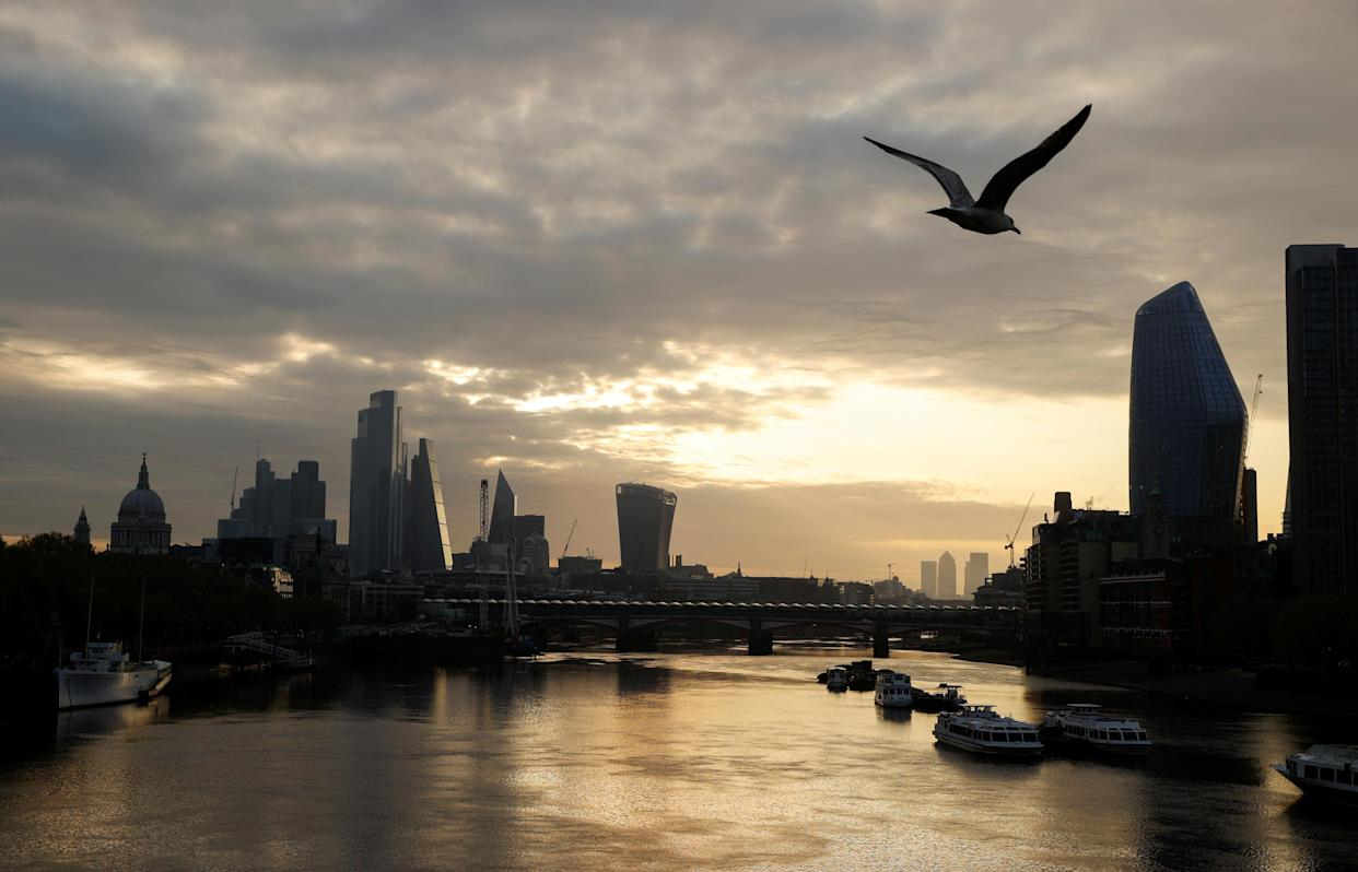 The city of London financial district is seen over the Thames