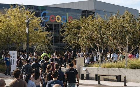Employees walk out at Google's Mountain View headquarters - Credit: Getty Images
