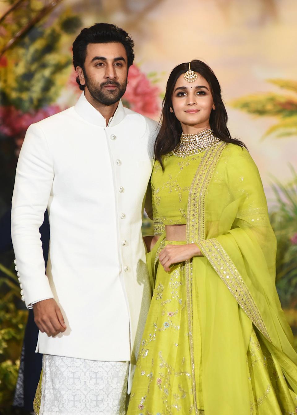Indian Bollywood actors Ranbir Kapoor (L) and Alia Bhatt pose for a picture during the wedding reception of actress Sonam Kapoor and businessman Anand Ahuja in Mumbai late on May 8, 2018. (Photo by Sujit Jaiswal / AFP)        (Photo credit should read SUJIT JAISWAL/AFP via Getty Images)