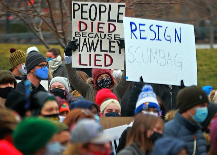 Demonstrators gather Jan. 9, 2021, outside the Old Courthouse in downtown St. Louis, calling for Sen. Hawley to resign.