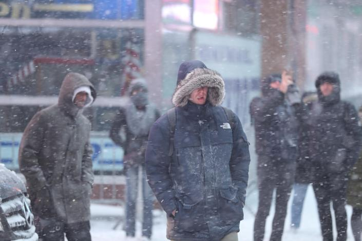 <p>A group of people cross W. 42nd Street in Times Square, New York City, during a winter snowstorm on Thursday, Jan. 4, 2018. (Photo: Gordon Donovan/Yahoo News) </p>