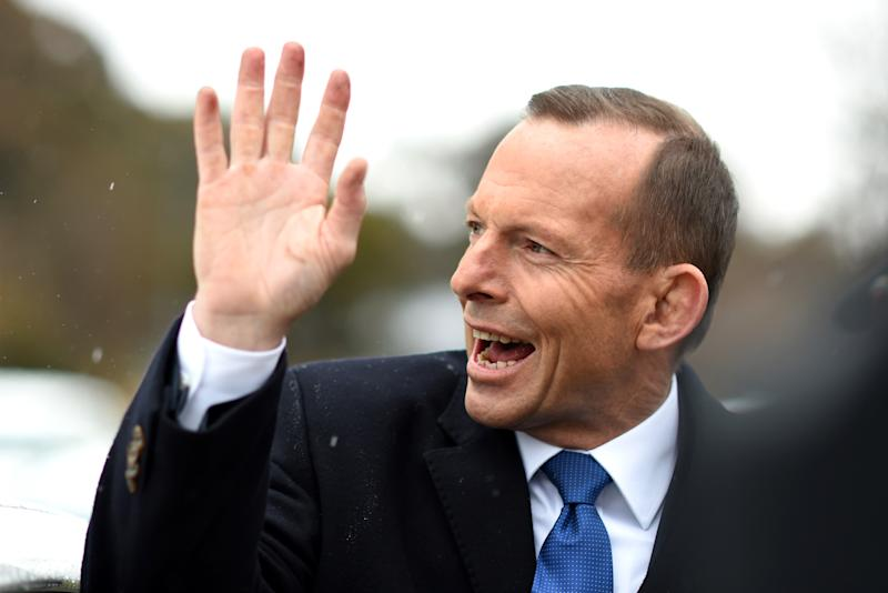 Australian Prime Minister Tony Abbott waves as he leaves after visiting a Green Army volunteering project in Queanbeyan, near Canberra, Wednesday, Aug. 12, 2015. (AAP Image/Lukas Coch) NO ARCHIVING