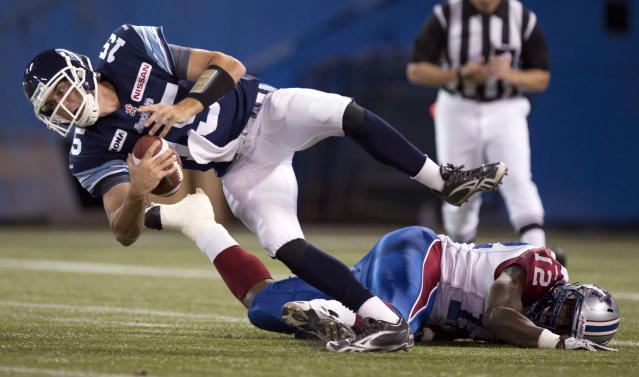 Toronto Argonauts quarterback Ricky Ray (15) is sacked by Montreal Alouettes linebacker Rod Davis (12) during first half CFL pre-season action in Toronto on Tuesday June 19, 2012. THE CANADIAN PRESS/FRANK GUNN