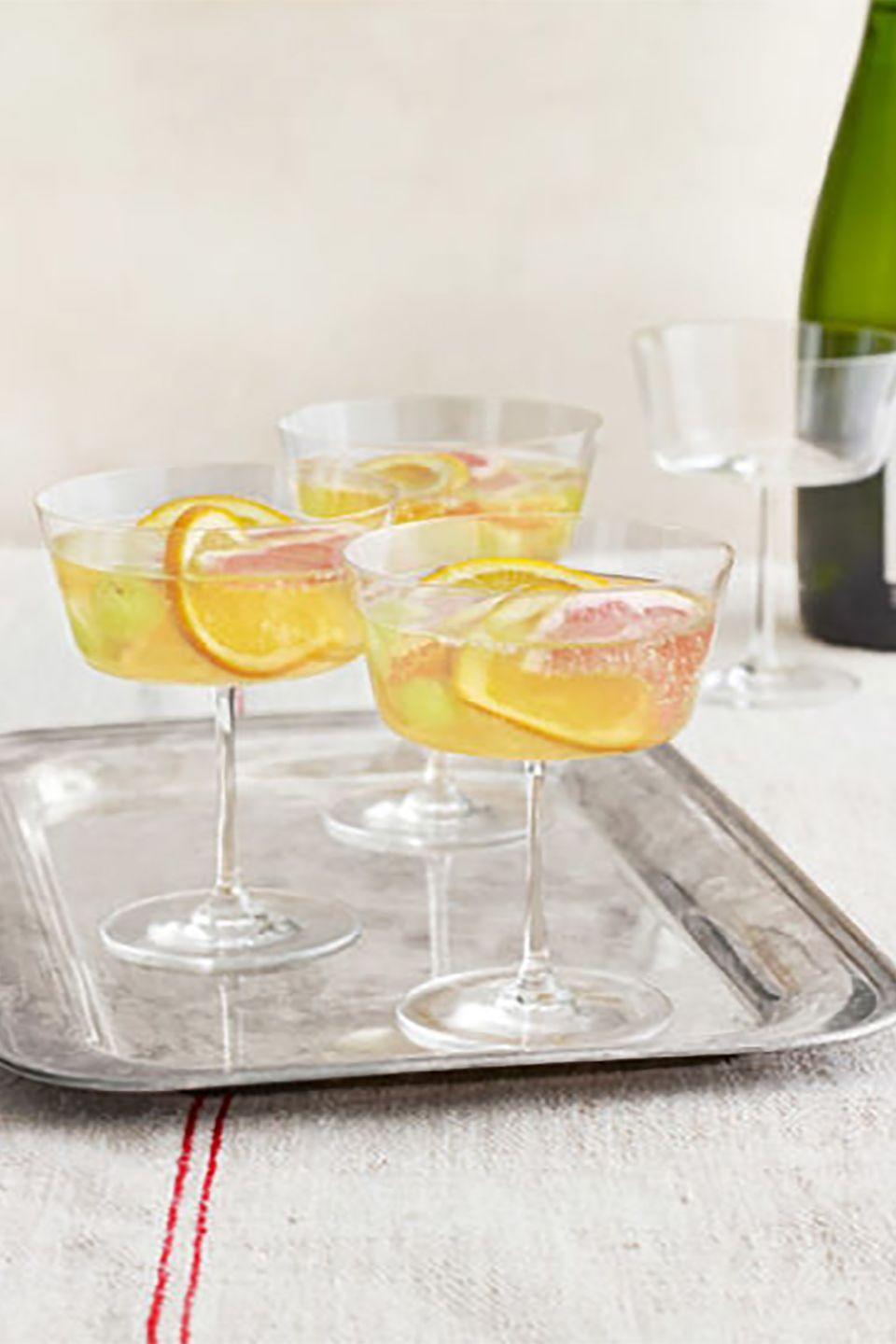 """<p>Try a new take on New Year's bubbly by sipping this cocktail, featuring St-Germain-soaked winter fruit and prosecco.</p><p><strong><a href=""""https://www.countryliving.com/food-drinks/recipes/a4280/sparkling-winter-sangria-recipe-clv1212/"""" rel=""""nofollow noopener"""" target=""""_blank"""" data-ylk=""""slk:Get the recipe"""" class=""""link rapid-noclick-resp"""">Get the recipe</a>.</strong></p>"""