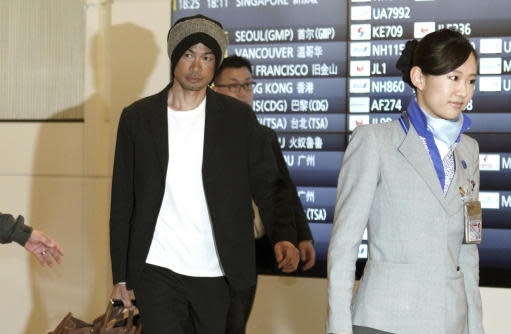 Seattle Mariners' Ichiro Suzuki is escorted upon his team's arrival at Haneda international airport in Tokyo Friday, March 15, 2019. The Mariners will play in a two-baseball game series against the Oakland Athletics to open the Major League season on March 20-21 at the Tokyo Dome. (AP Photo/Eugene Hoshiko)