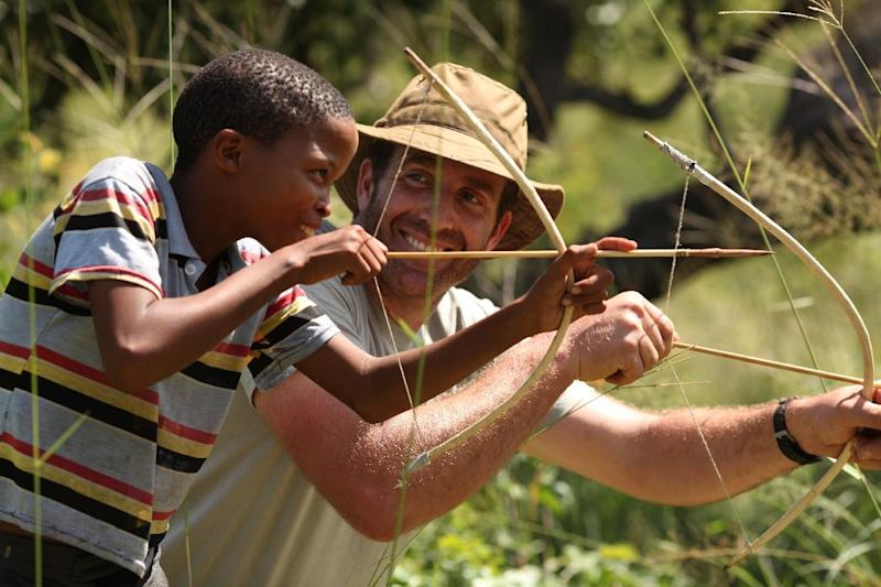 """In this undated image released by Animal Planet, survivalist Guy Grieve, right, uses bow and arrow during the filming of """"The Hunger,"""" a new adventure series  that explores the ingenious methods used by disparate world cultures to find, capture, cultivate and consume food. (AP Photo/Animal Planet)"""