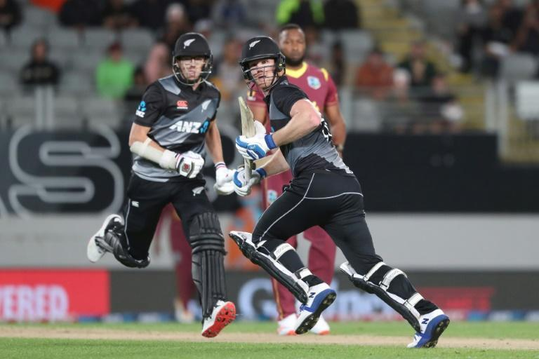 Jimmy Neesham (right) steered the New Zealanders home with Mitchell Santner (left), who hit a six to claim victory