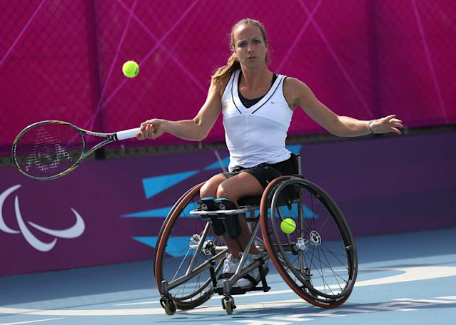 Jiske Griffioen of the Netherlands plays a return to Sabine Ellerbrock of Germany during the women's singles wheelchair tennis bronze medal match at the 2012 Paralympics games, Thursday, Sept. 6, 2012, in London. Griffioen won the match and takes the bronze medal. (AP Photo/Raissa Ioussouf)