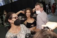<p>Backstage, Irina Shayk gets fitted for a look at the Etro show during Milan Fashion Week. </p>